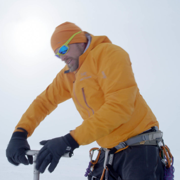 Jason Box takes a snow sample on the Greenland Ice Cap.