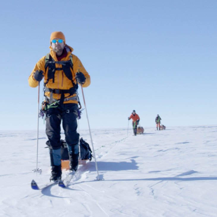 Jason Box explores the Greenland Ice Cap using skis and haul sleds.